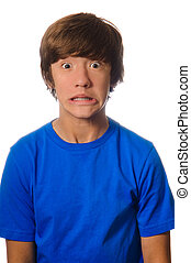 Scared Face Teen - Scared teen with wide opened eyes wearing...