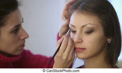 Make-up - Model making-up for photo session in studio