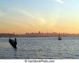 Sailboat on San Francisco Bay approaching breakwater -...