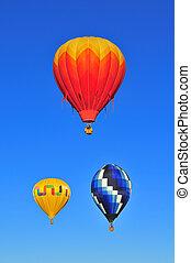 3 hot air balloons against blue sky at 2008 Albuquerque...