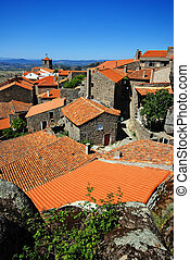 stone village with red roofs