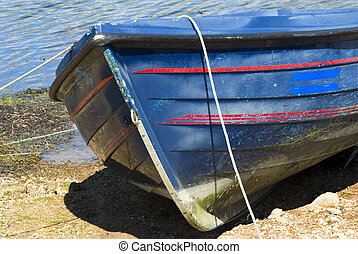 Fishing dinghy on a pebble beach - Sturdy wooden...