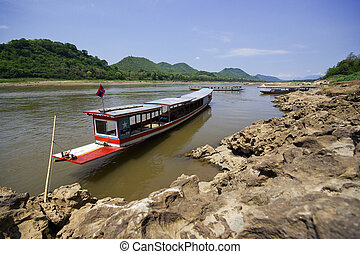 Boat on Mekong river, border crossing, checkpoint