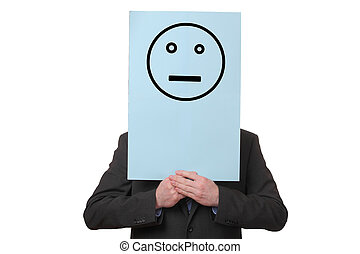 Businessman holding a paper with a neutral smiley on white...