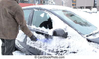 man cleaning snow car