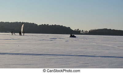 snowmobile sun evening - snowmobile transport cross frozen...