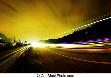 Highway at night   - Cars pass on a country road at night