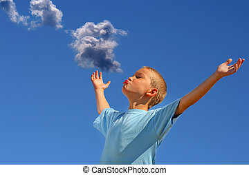 Boy On Sky Background - Young Boy with hands up on the Blue...