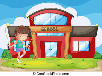A girl playing in front of the school