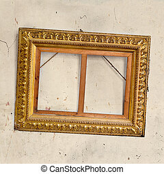 Vintage picture frame on old dirty wall
