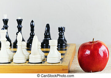 Chess On The Chess Board And Red Ripe Apple