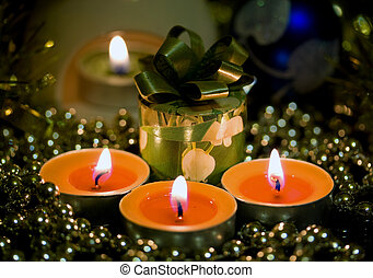 Holiday gift, candle in a mysterious and romantic atmosphere