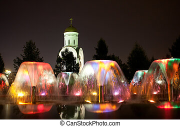 Coloured fountain Moscow - Coloured fountain and church at...