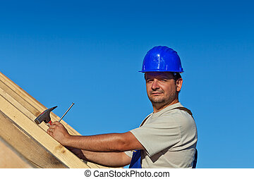 Proud construction worker on the roof