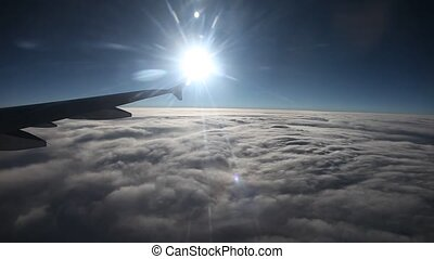 Flight With Sun Over Clouds