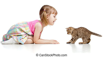 child girl playing with cat kitten - child girl playing with...