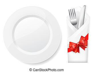white plate,fork and knife in envelope with bow
