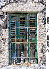 Barred Window Santorini - A run down rusty barred window...