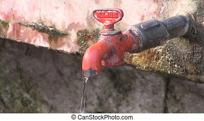old and dirty water taps in Agra street, India