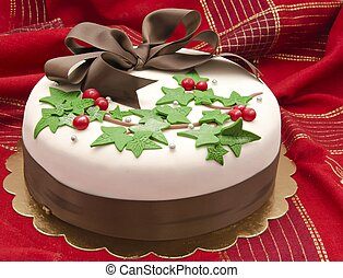 Christmas cake decorated with fondant holly leaves