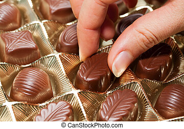 Chocolate sweets on the hand