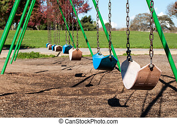 row of empty swings - large swing set, empty swings, loss,...