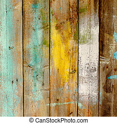 Background old wooden fence painted in different colors -...