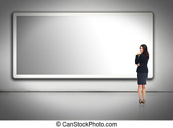 Business woman near billboard. - Business woman standing...
