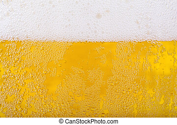 Beer background - Beer and white froth background Closeup...