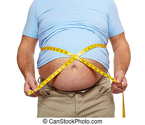 Fat man with a big belly - Fat man holding a measuring tape...