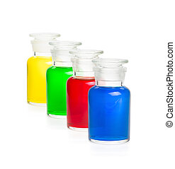 Four laboratory bottles filled with colorful liquids