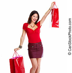 Beautiful woman with a shopping bags. Isolated on white...