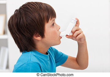 Boy using inhaler - respiratory system illness
