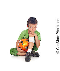 Boy with injured leg and soccer ball - Boy with injured leg...