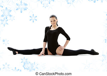fitness instructor in black leotard with snowflakes