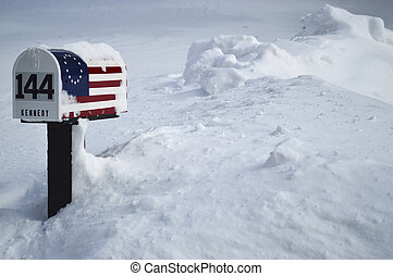 Patriotic residential mailbox almost buried by snow