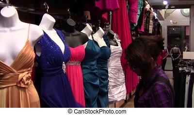 Shopping for Prom Dress - Teen girl examining prom dress