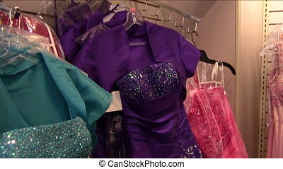 Shopping for Prom Dress - Teen girl looking at price tag of...