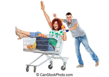 humorous shopping - Cheerful couple with a shopping trolley....
