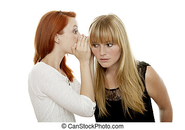 young beautiful red and blond haired girls telling a secret...
