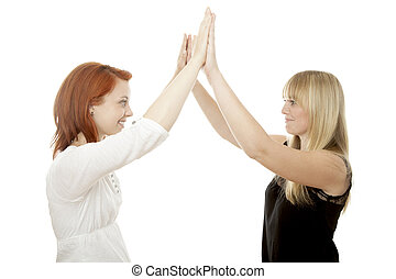 young beautiful red and blond haired girls high five - young...