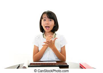 Smiling Asian schoolgirl