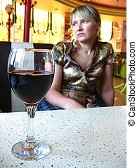 the girl with glass of red wine in restaurant