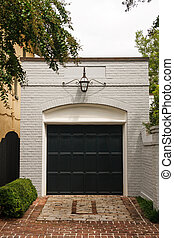 White Brick Garage with Black Door - An old white brick free...