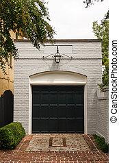 White Brick Garage with Black Door - An old white brick free...