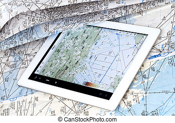 Comparison between a map of paper and an electronic flight...