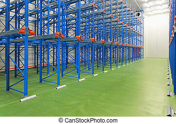 New empty warehouse - Empty blue shelves in new distribution...