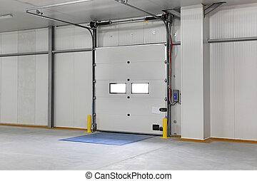 Warehouse door - Closed automated cargo door in distribution...
