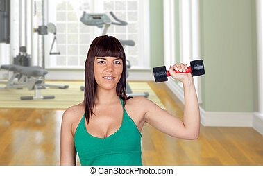 Beautiful girl with a weighttraining in the gym