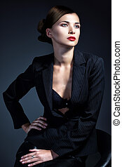 Portrait of sexy business woman in a suit. Professional makeup and hairstyle
